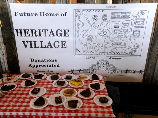 A map of the proposed Heritage Village in Comanche hangs above the desserts during a fundraiser luncheon Monday, Feb. 27, 2017, in Comanche. Revitalize Comanche, a historical preservation group, is turning the former Higginbotham Brothers hardware store into a museum and is also creating the park.