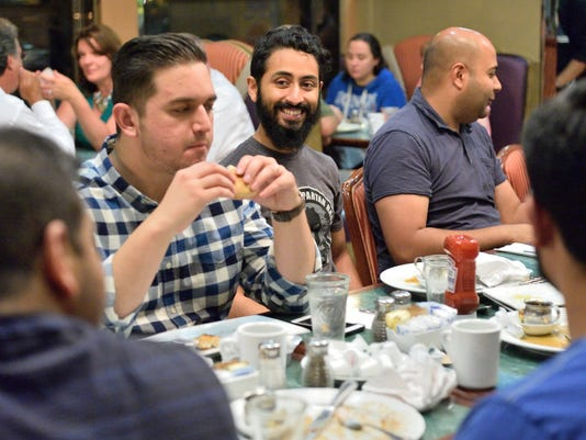 Muslim friends meet at the Chit Chat diner for a suhoor during Ramadan