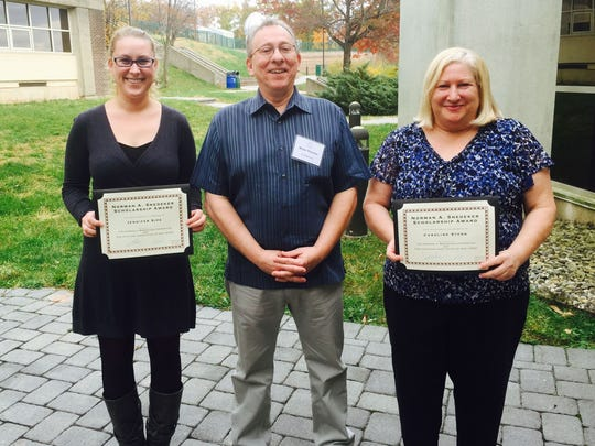 RVCC Ophthalmic Science students Jennifer Sipe, left, and Caroline Stern, right, stand with their RVCC professor, Dr. Brian Thomas. The students have been named recipients of the Norman Snedeker/OANJ memorial scholarship from the Opticians Association of New Jersey (OANJ).