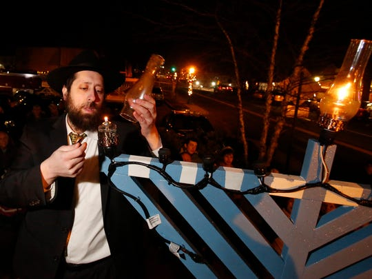 Rabbi Dovid Labkowski of Chabad Lubavitch of Briarcliff Manor and Ossining leads a prayer at the Menorah lighting at Pocket Park in Briarcliff Manor on Dec. 6, 2015.