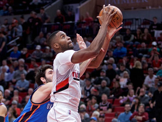 Portland Trail Blazers forward Maurice Harkless, right, shoots over Oklahoma City Thunder guard Alex Abrines during the second half of an NBA basketball game in Portland, Ore., Thursday, March 2, 2017. (AP Photo/Craig Mitchelldyer)