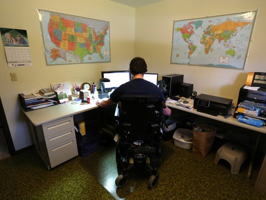 Lon Krause works at his home office in Marshfield,