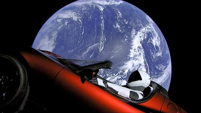 This image from video provided by SpaceX shows the company's spacesuit in Elon Musk's red Tesla sports car which was launched into space during the first test flight of the Falcon Heavy rocket on Tuesday, Feb. 6, 2018. (SpaceX via AP) ORG XMIT: NY318