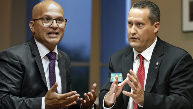 David Santiago, left, debated Will Roberts at The Daytona Beach News-Journal on Monday. Election Day for the new tax collector takes place Aug. 18.