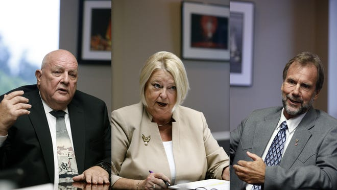 Candidates for Volusia County Chair Gerard Witman, left, Councilwoman Deb Denys, center, and Jeff Brower, right, are seen speaking about issues at a debate held at The Daytona Beach News-Journal on Thursday night. The open election is August 18.