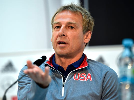 FILE - In this June 9, 2015 file picture US head coach Juergen Klinsmann attends a  news  conference  in Cologne, Germany. Juergen Klinsmann, a World Cup winner with Germany, has been named honorary captain of the German national team the Football Federation announced Thursday Nov. 3, 2016. Klinsmann became only the fifth player to receive the distinction, after Fritz Walter, Uwe Seeler, Franz Beckenbauer and Lothar Matthaeus. (AP Photo/Martin Meissner, file)