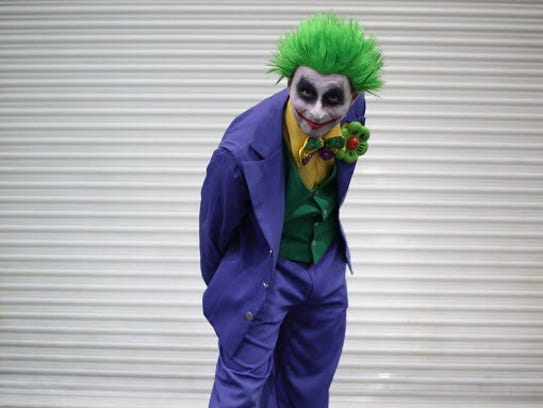 A visitor to the London Super Comic Convention wears