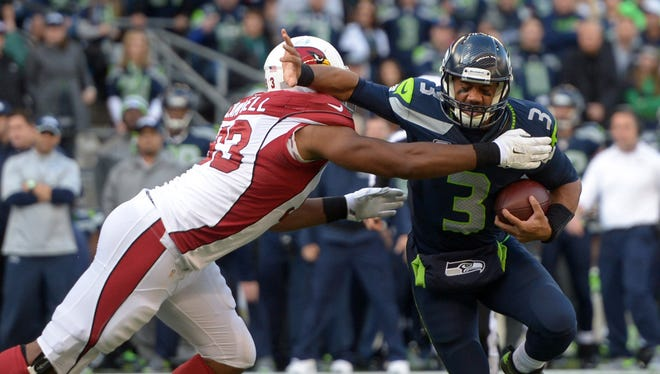 Nov 23, 2014: Seattle Seahawks quarterback Russell Wilson (3) is pressured by Arizona Cardinals defensive tackle Calais Campbell (93) at CenturyLink Field.