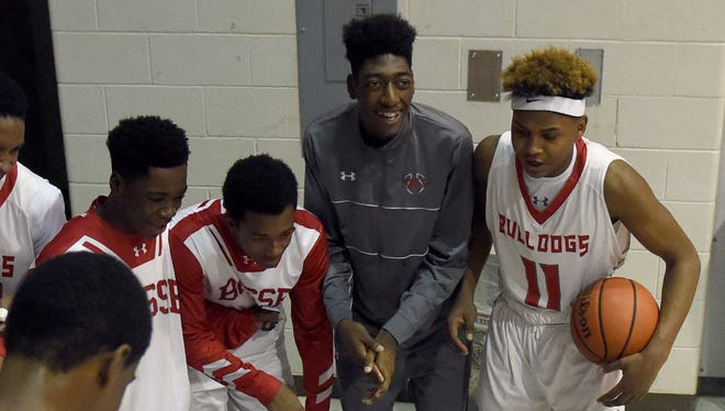 Romeo Parker, top center, relaxes with Bosse teammates before going up against North at Bosse in Evansville Saturday.  Parker was the lead male role in the schoolÕs fall play, ÒThe Insanity of Mary Girard.Ó
