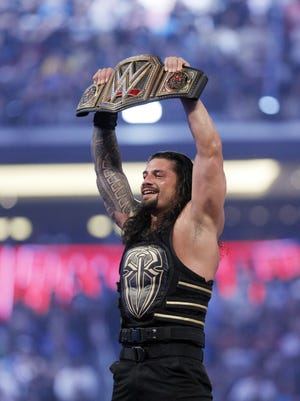WWE's Roman Reigns celebrates his victory at WrestleMania 32 on April 3, 2016, in Arlington, Texas.