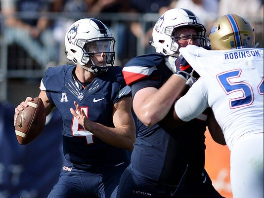 Connecticut quarterback Bryant Shirreffs (4) looks to pass in the second half of the NCAA college football game against Tulsa, Saturday, Oct. 21, 2017, in East Hartford, Conn. Connecticut won, 20-14. (AP Photo/Stephen Dunn)