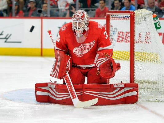 Detroit Red Wings goaltender Jimmy Howard (35) blocks a shot against the Nashville Predators in the first period of an NHL hockey game, Tuesday, Feb. 20, 2018, in Detroit. (AP Photo/Jose Juarez)