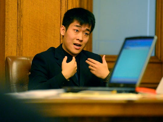 Meng Long Li answers questions from prosecutors last week during his trial in Ingham County Circuit Court. Li and co-defendant Shan Gao were accused of beating an MSU student.