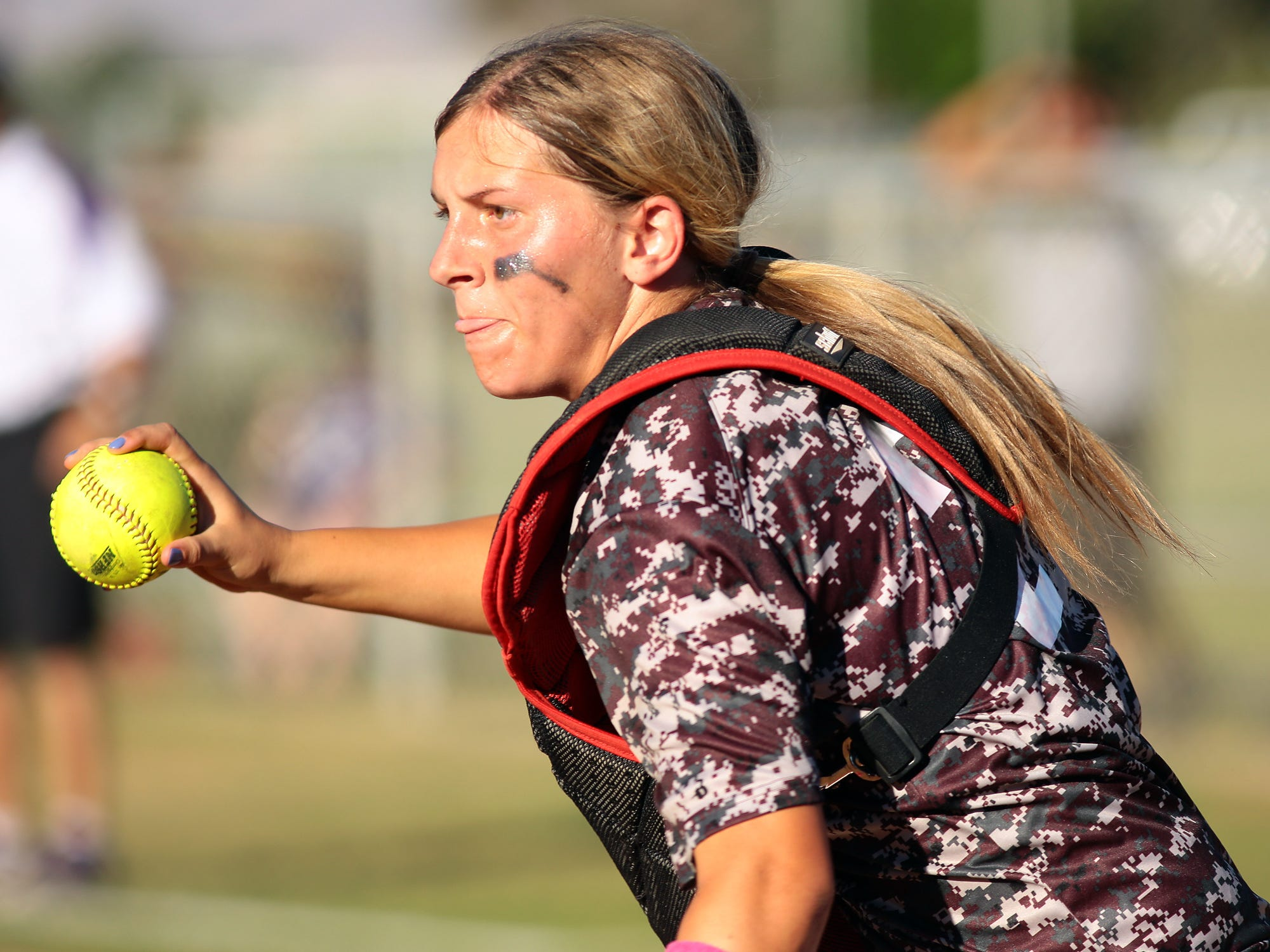 La Quinta catcher Kelli Finan runs up the third base line to make a play against Shadow Hills on Thursday afternoon, March 26, 2015 during a game at La Quinta High School. La Quinta won the first game 7-5 and took another win 4-1.