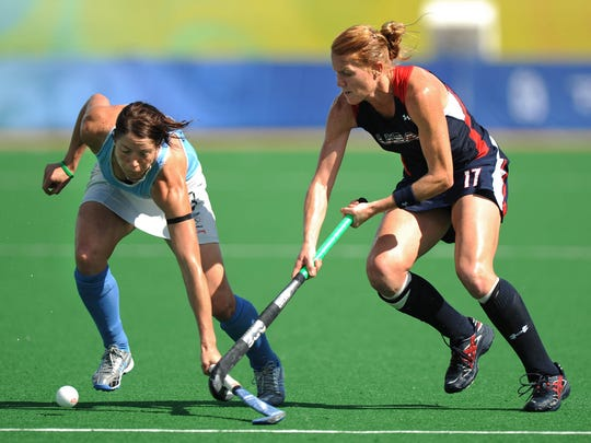 United States' Carrie Lingo hooks the stick of New