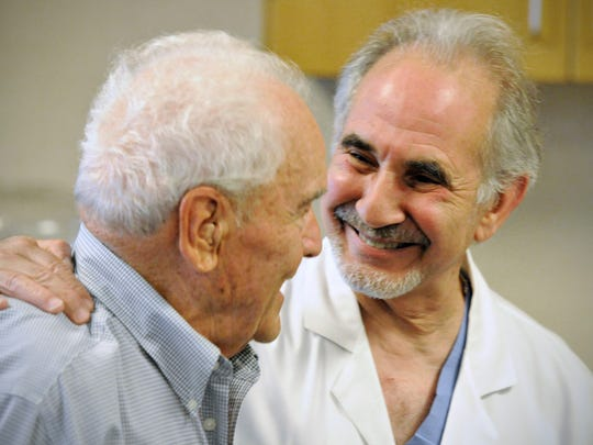 Clarence Enneking (left) talks July 24 with cardiac surgeon Dr. John Teskey. Teskey was on the team that performed Enneking's transcatheter aortic valve replacement at the CentraCare Heart & Vascular Center.