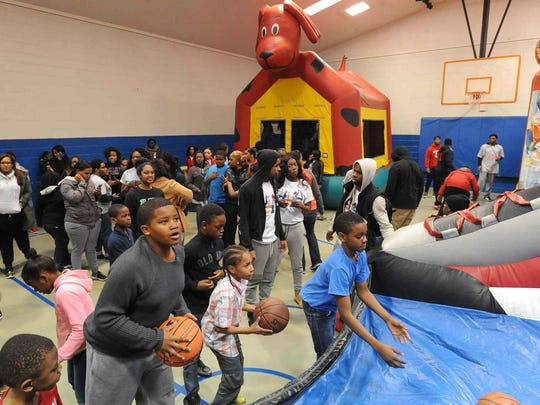"""Kids take part in activities at the Greater Boys and Girls Club in Dover.""""This was supposed to be an outside event – but at DSU, we know how to make things work,"""" an emcee said."""