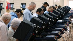 People cast their ballots in Carson City, Nev., on