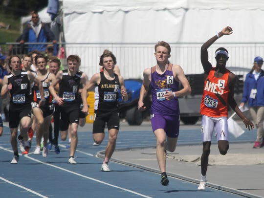 Johnston senior Joe Schaefer kics to the finish of