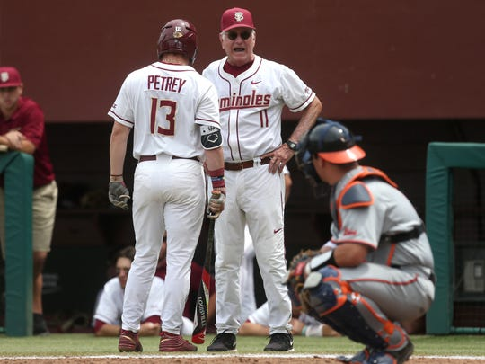 FSU Head Coach Mike Martin yells out to Donovan Petrey during Virginia's 8-0 win at Dick Howser Stadium on Saturday.