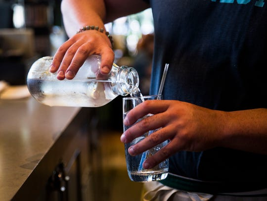 Tim Yaple, bartender at True Food Kitchen, pours a