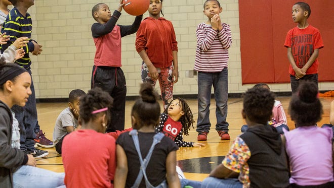 Tyler Gordon, an eight year old who was struck by a bullet at Heekin Park last year, plays ball at the Unity Center. Gordon and his family will be working with the Unity Center and Champions for a Safe Community, who have started a year-long effort to reduce gun violence.