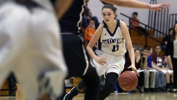 Putnam Valley's Kelli Venezia (13) drives to the basket