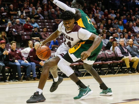 Alize Johnson goes around a defender during Missouri State University's game against North Dakota State at JQH Arena on Friday, Nov. 17, 2017.