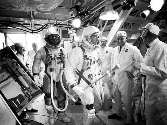 In this June 3, 1966, photo provided by NASA, Gemini IXA astronauts Eugene Cernan, left, and Tom Stafford, center, arrive in the white room atop Launch Pad 19 at Cape Kennedy Air Force Station in Cape Canaveral, Fla. NASA announced that former astronaut Cernan, the last man to walk on the moon, died Monday, Jan. 16, 2017, surrounded by his family. He was 82.