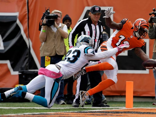 Cincinnati Bengals wide receiver Mohamed Sanu (12) scores past Carolina Panthers cornerback Melvin White (23) on a 34-yard touchdown after catching a pass in the second half of an NFL football game, Sunday, Oct. 12, 2014, in Cincinnati. (AP Photo/AJ Mast)