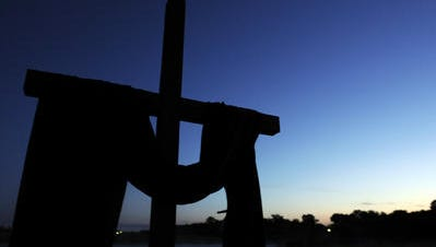 A cross stands before Frazer Memorial United Methodist Church's sunrise Easter service on Sunday, April 8, 2012.