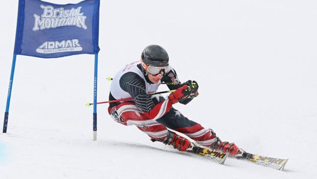 Jonathan Yudell of New Rochelle/Bronxville tucks tight around a gate at the NYSPHSAA Giant Slalom Skiing Championships Feb. 25, 2014. Yudell place third in the event.