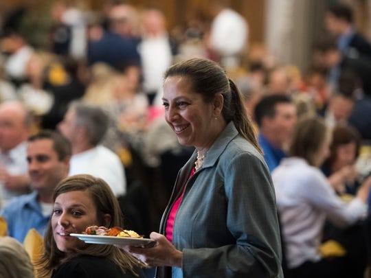 Martha Leuvke of U.S. Cellular walks towards her seat during the News Sentinel's 2018 Top Work Places awards ceremony at the Foundry in World's Fair Park Tuesday, June 19, 2018.