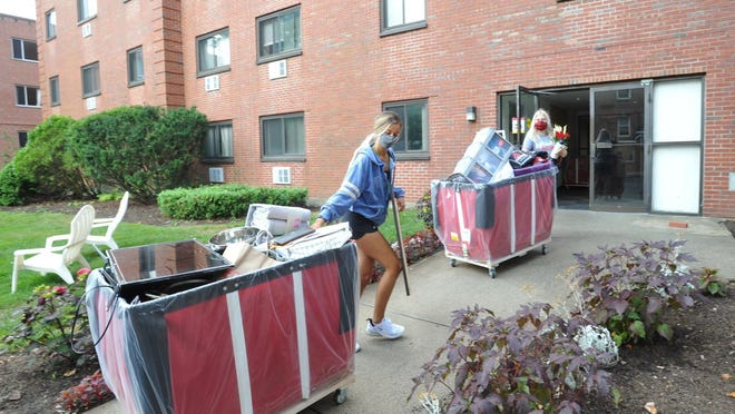 Sarah Moschini of Upton left, and Jakki Cloutier of Whitinsville, move their belongings into the Eastern Nazarene College dorm on Saturday, Aug. 22, 2020. Tom Gorman/For The Patriot Ledger