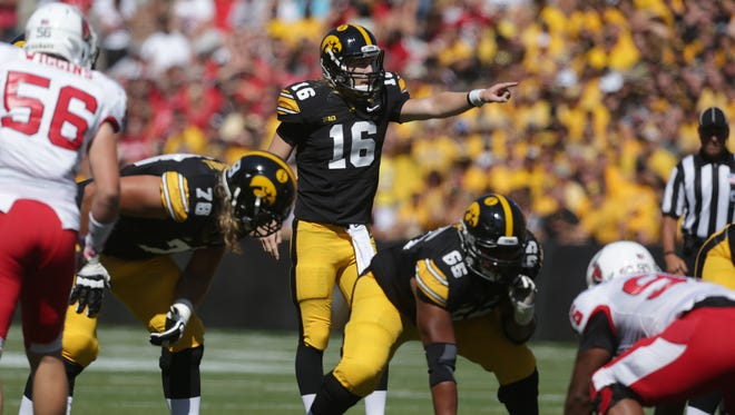 Iowa quarterback C.J. Beathard points out Ball State's defensive position on Saturday, Sept. 6, 2014, at Kinnick Stadium in Iowa City, Iowa.