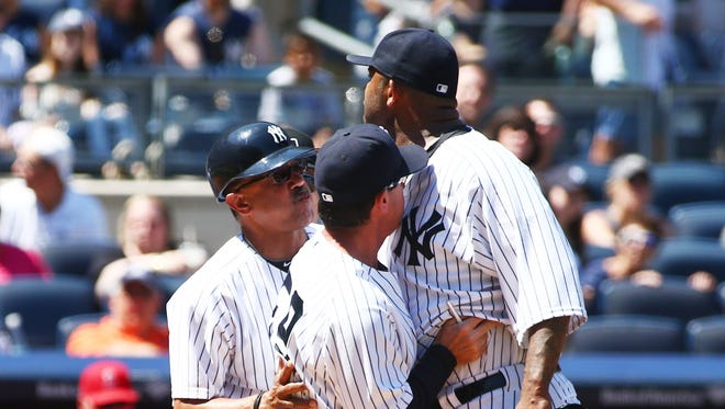CC Sabathia was ejected after arguing with home plate umpire Dan Bellino, but he stuck around long enough to get the win.
