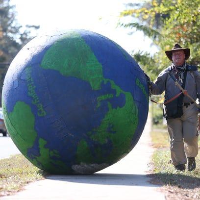 Erik Bendl of Louisville, Ky. walks across Tallahassee
