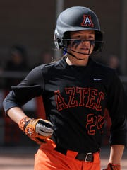 Aztec's Jocelyn Ulrich heads to first base during the game between the Lady Tigers and the Miyamura Lady Patriots on Friday April 1, 2016, at the Aztec Tiger Sports Complex.