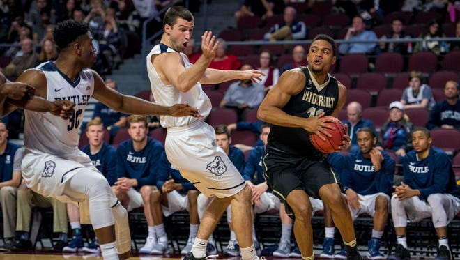 Vanderbilt Commodores forward Jeff Roberson (11) moves with the ball while being defended by Butler Bulldogs forward Andrew Chrabascz (45) during the first half at Orleans Arena.