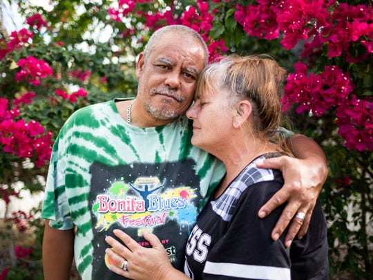 "Rodney and Lori Malone stand together for a portrait in the yard of their Bonita Springs home on Friday, Dec. 8, 2017. ""Going through the hurricane was nothing,"" compared with what the couple has faced in the aftermath of Hurricane Irma, Rodney Malone said."