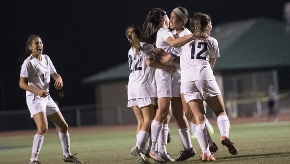 Chambersburg celebrates during a victory against Greencastle