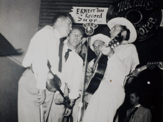 Hank Williams, right, performs with Don Helms and others