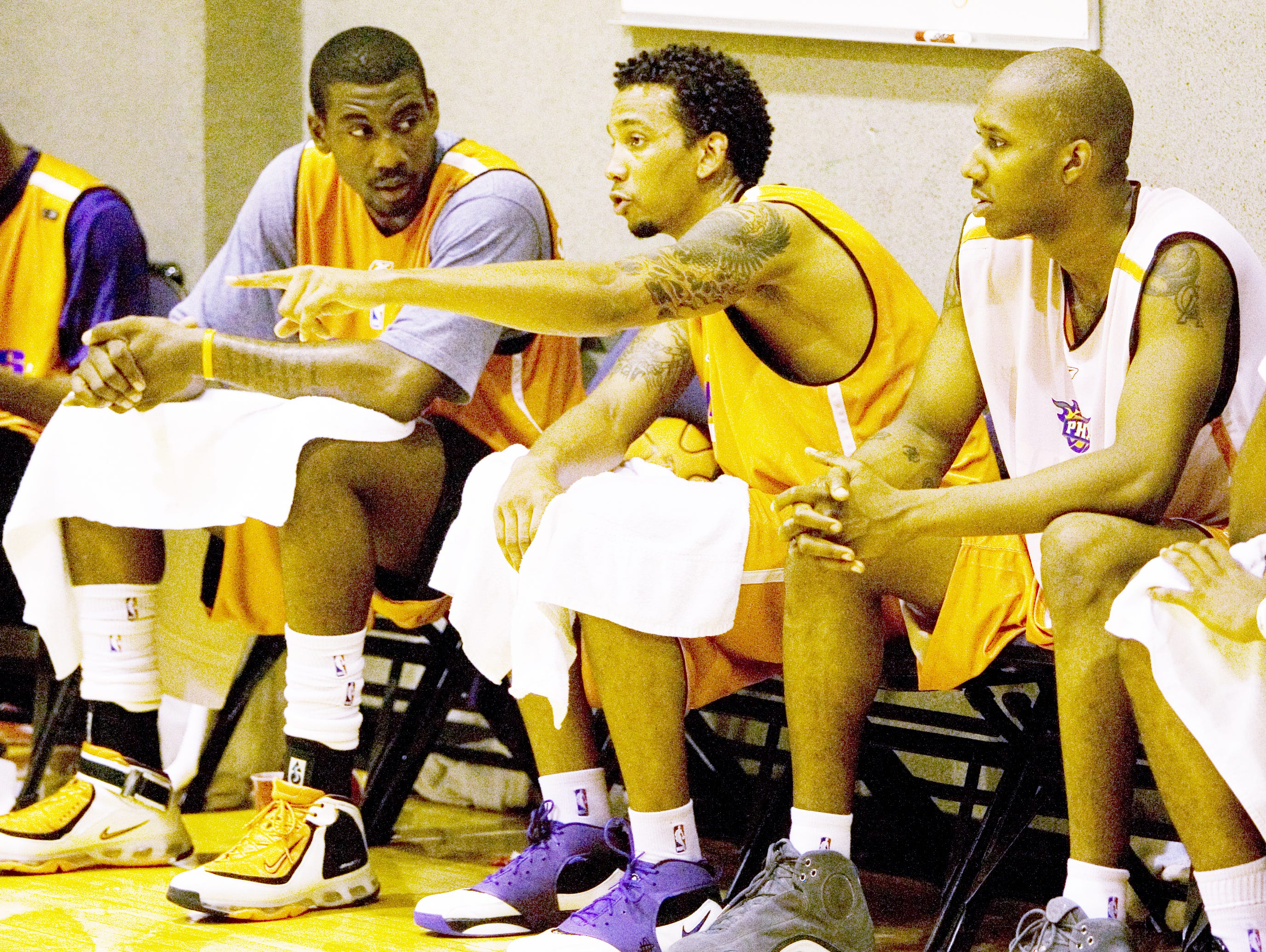 Tommy Smith (center) talks to Amar'e Stoudemire during Phoenix Suns practice at US Airways Center on July 5, 2006.