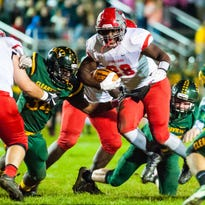 Vineland running back Daivon Seymore (28) rushes against Clearview at Clearview Regional High School in Mullica Hill on Friday, October 14.