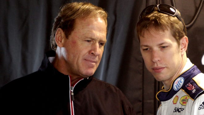 NASCAR Hall of Famer Rusty Wallace (left), shown here with 2012 Cup champion Brad Keselowski, says one of his favorite memories outside a race car was flying an F-18.