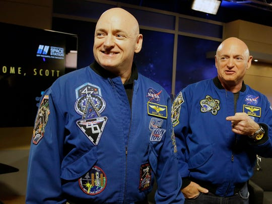 Double vision? NASA astronaut Scott Kelly, left, and