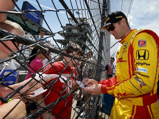 Andretti Autosport IndyCar driver Ryan Hunter-Reay (28) signs autographs for school kids on a field trip during practice for the Indianapolis 500 Wednesday, May 17, 2017, afternoon at the Indianapolis Motor Speedway.