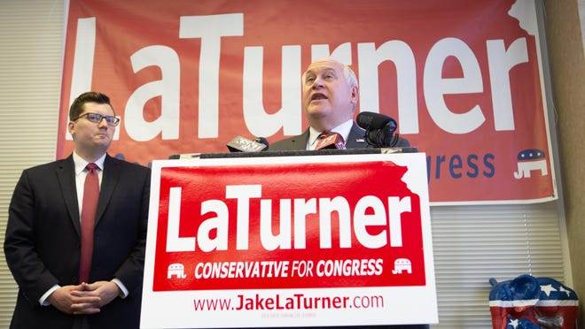 Rep. Ron Estes, right, endorsed Kansas State Treasurer Jake LaTurner during a news conference Thursday afternoon at the GOP headquarters in Topeka.