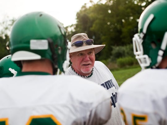 Fairfield's new head coach, Darwin Seiler, talks with his players during a practice before the start of the 2012 season.