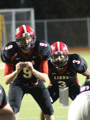 New Richmond sophomore quarterback Gage Kramer calls out the play against Goshen with senior Tyler Anderson in the backfield.